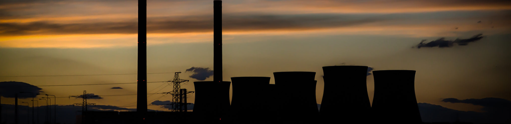 The sun sets behind Ferrybridge C Power Station