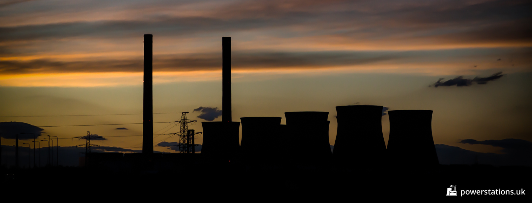 The sun sets behind the dormant Ferrybridge C Power Station