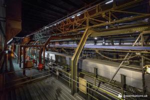 Enclosed conveyor for transportation of biomass