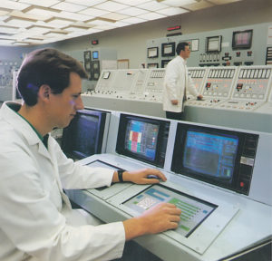Operators at the panels of the original control room