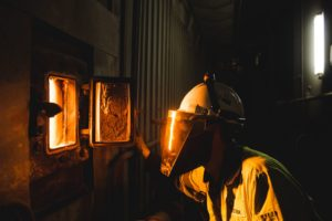 Engineer looking into Biomass furnace [Image courtesy Drax Power]