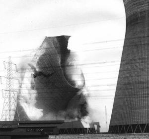 One of the cooling towers collapsing
