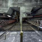 Conveyors below the rial-unloader hoppers