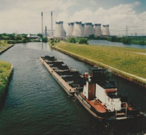 A barge train approaching Ferrybridge loaded with coal