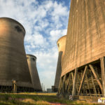 Between the cooling towers