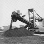 Giant boom stacker in operation, 1970